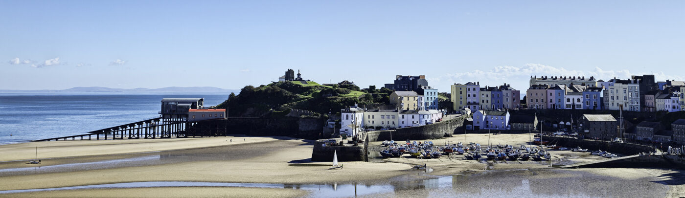 Tenby in Pembrokeshire. View of the North Beach in on a clear October day during low tide.